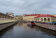 St. Petersburg, Russia -- July 20, 2019. Two tour boats are docked side by side in one of the canals of St Petersburg, Russia.