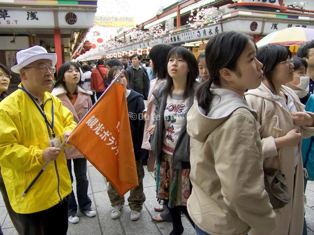 Japanese student tourist at the Asakusa Kannon Temple Tokyo