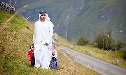 THEMENBILD, Arabische Gäste bei einem Ausflug auf die Fürthermoar Alm bei den Hochgebirgsstauseen Kaprun, ein Araber auf einer Bergwiese. Jedes Jahr besuchen mehrere Tausend Gäste aus dem arabischen Raum die Urlaubsregion im Salzburger Pinzgau, aufgenommen am 29.08.2013 in Kaprun, Österreich // Arab guests at a trip to the Fuerthermoar Alm at the Kaprun Alpine Reservoirs. Every year thousands of guests from Arab countries takes their holiday in Zell am See - Kaprun Region, Kaprun, Austria on 2013/08/29. EXPA Pictures © 2013, PhotoCredit: EXPA/ JFK