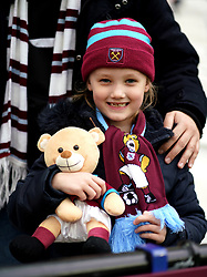 A young West Ham United fan in the stands during the Premier League match at London Stadium.