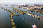 Nederland, Noord-Holland, IJmuiden, 16-04-2008; sluizencomplex aan het begin van het Noordzee kanaal, schip verlaat de Noordersluis; in de achtergrond op het terrein van Corus (voorheen Hoogovens); Noordzeekanaal, sluis, sluizen, schutten, kolk, zeesluis;.channel mouth North Sea canal witk locks; Corus steel industry in the backgroud; Corus is part of the Tata Steel Group and produces hot-rolled, cold-rolled and metallic-coated steels; steel, iron, coke, ore, coal, cokes, chimney, blast furnaces...  .luchtfoto (toeslag); aerial photo (additional fee required); .foto Siebe Swart / photo Siebe Swart
