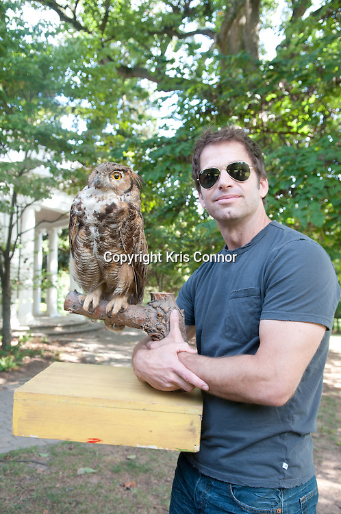 """Director Zack Snyder poses with a replica of an owl during a visit to promote the new Warner Brothers' movie """"Legend of the Guardians: The Owls of Ga'Hoole,"""" at the Audubon Naturalist Society Wildlife Sanctury in Chevy Chase, Md on September 14, 2010. Photo by Kris Connor"""