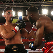 Daniel Rosario (L) gets punched by the right hand of Alphonso Black during a Telemundo Boxeo boxing match at the A La Carte Pavilion on Friday,  March 13, 2015 in Tampa, Florida.  (AP Photo/Alex Menendez)