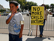 Michael Jackson fan Ernesto Ramirez (5) stands outside the courthouse where the Jackson trial is taking place in Santa Maria, California June 3, 2005. Jurors in Jackson's molestation trial on began weighing the charges against the pop star after dueling closing arguments portrayed him as either a sexual predator or the naive victim of a family of hardened liars. ..