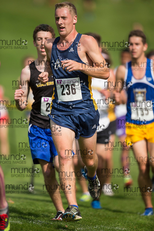 Alex Rocheleau of the Windsor Lancers runs at the 2014 Western International Cross country meet in London Ontario, Saturday,  September 20, 2014.<br /> Mundo Sport Images/ Geoff Robins