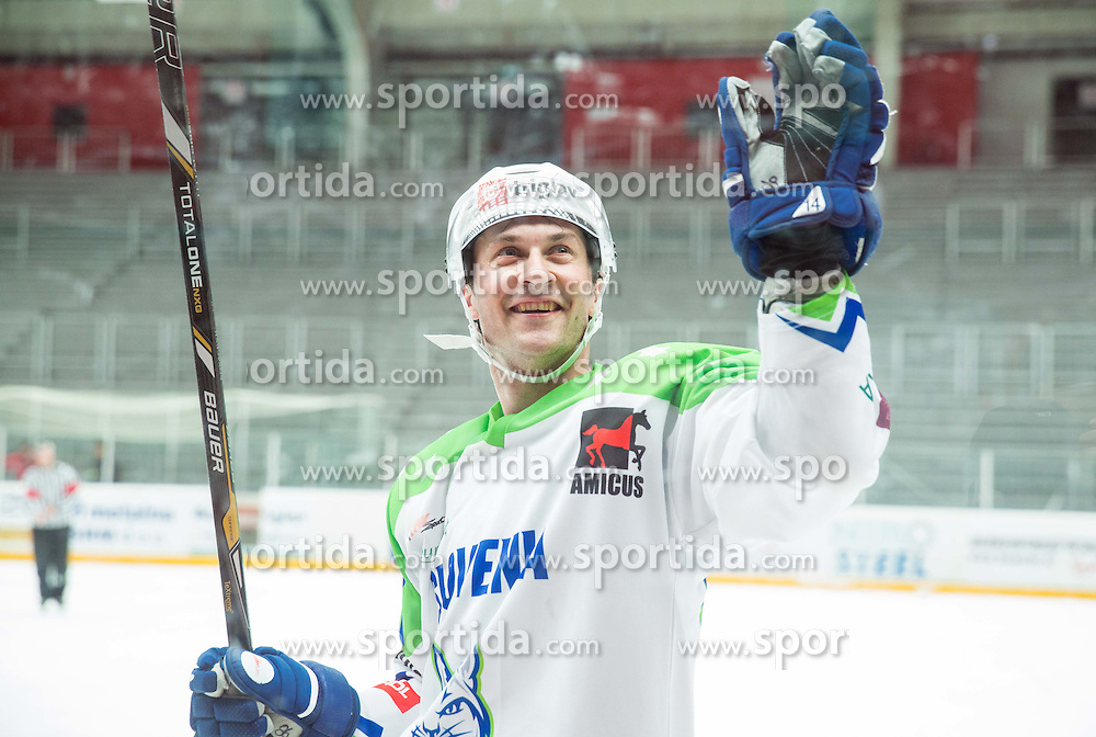 Sabahudin Kovacevic of Slovenia celebrates after winning during ice-hockey friendly match between National teams of Slovenia and Japan, on April 10, 2015 in Arena Podmezakla, Jesenice, Slovenia. Photo by Vid Ponikvar / Sportida