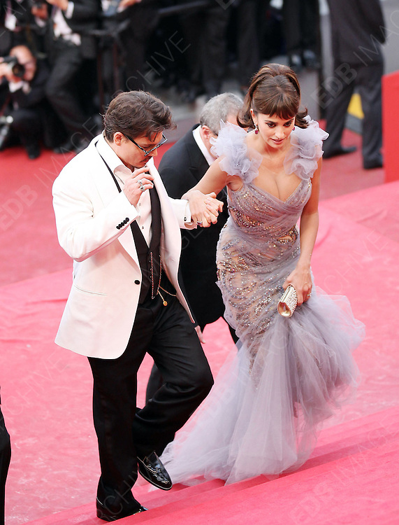 14.MAY.2011. CANNES<br /> <br /> PENELOPE CRUZ AND JOHNNY DEPP ON THE RED CARPET FOR THE PIRATES OF THE CARIBBEAN: ON THE STRANGER TIDES PREMIERE AT THE 64TH CANNES INTERNATIONAL FILM FESTIVAL 2011 IN CANNES, FRANCE<br /> <br /> BYLINE: EDBIMAGEARCHIVE.COM<br /> <br /> *THIS IMAGE IS STRICTLY FOR UK NEWSPAPERS AND MAGAZINES ONLY*<br /> *FOR WORLD WIDE SALES AND WEB USE PLEASE CONTACT EDBIMAGEARCHIVE - 0208 954 5968*