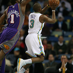 Chris Paul shoots for the New Orleans Hornets against the Phoenix Suns on February 26, 2008 at the New Orleans Arena in New Orleans, Louisiana. The New Orleans Hornets defeated the Phoenix Suns 120-103.