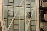 window cleaner on scaffoling by building