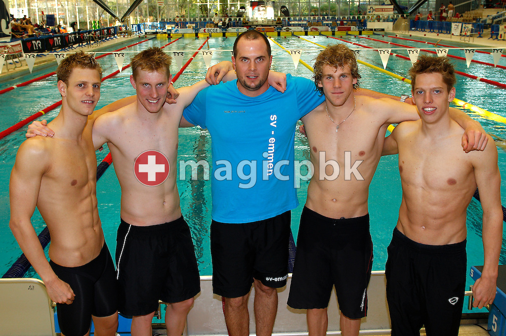 (L-R) Nico VAN DUIJN, Simon RABOLD, coach Tobias GROSS, Erik VAN DOOREN and Alexandre LIESS pose for a photo at the Swiss Swimming Championships in Geneva, Switzerland, Friday, April 1, 2011. A few weeks ago the four swimmers finished their 18 weeks basic military training (boot camp, military training school) for elite sportsmen. (Photo by Patrick B. Kraemer / MAGICPBK)