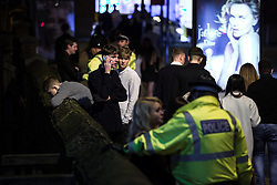 "© Licensed to London News Pictures . 19/12/2015 . Manchester , UK . A man leans over a wall overlooking a canal at Deansgate Locks . Revellers in Manchester enjoy "" Mad Friday "" - also known as "" Black Eye Friday "" - the day on which emergency services in Britain are typically at their busiest , as people head out for parties and drinks to celebrate Christmas . Photo credit : Joel Goodman/LNP"