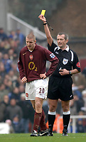 Photo: Daniel Hambury.<br />Arsenal v Cardiff City. The FA Cup. 07/01/2006.<br />Arsenal's Philippe Sanderos is booked by referee Martin Atkinson.