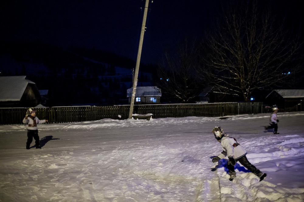 ILTSI, UKRAINE - JANUARY 6: Stas, Vasyl, and Nazar Mahulia (L-R), ages 5, 7, and 6 respectively, pause for a snowball fight while caroling door to door in celebration of Orthodox Christmas on January 6, 2015 in Iltsi, Ukraine. While many of the traditions are similar across Ukraine, the songs and clothing of the Hutsul culture are common in the Carpathian Mountains. (Photo by Brendan Hoffman/Getty Images) *** Local Caption *** Vasyl Mahulia;Stas Mahulia;Nazar Mahulia
