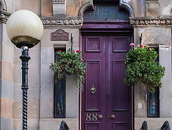 Detail of entrance to beautiful apartment building on Queens Drive in Queens Park district of Glasgow, Scotland, United Kingdom