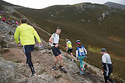 08/11/2014 repro free Rob Staunton from Westport  Mayo  on Croagh Patrick taking  part in the Sea 2 Summit adventure race in Westport Co. Mayo. Photo:Andrew Downes