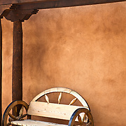 A welcoming banco (bench) in Old Town Albuquerque, where the warm, soft contours of adobe mirror the Southwestern landscape.