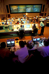 People operating technical devices at the control room at Transtar in Houston Texas