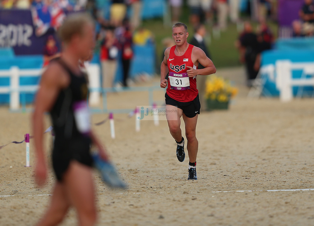 Dennis Bowsher of the USA crosses the finish line after finishing the men's modern pentathlon during day 15 of the London Olympic Games in London, England, United Kingdom on August 11, 2012..(Jed Jacobsohn/for The New York Times)..