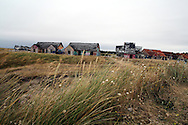Pirou ghost seaside village in Normandy. Born of a financial fiasco in the 90s, there are still 25 ruins of houses of what was supposed to be a holiday village. It has become a tourist attraction and an organic art hub with French famous artists like JR and Agnès Varda being involved in art projects.