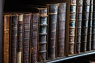 Vintage Leather Bound Books in Trinity College Library, Dublin, Ireland