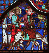 Jesus travelling on a donkey being blessed as he leaves, stained glass window from Laon Cathedral or the Cathedrale Notre-Dame de Laon, built 12th and 13th centuries in Gothic style, in Laon, Aisne, Picardy, France. The cathedral is listed as a historic monument. Picture by Manuel Cohen
