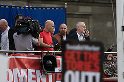 Parliament Square, Westminster, London, June 27th 2016. Thousands of Labour's Momentum members and their supporters gather in Parliament Square in a display of support for embattled Labour Leader Jeremy Corbyn as he suffers numerous calls for his resignation by party members, saying he has does not have the authority to lead the divided party, following his less than emphatic support for Remain in the EU referendum. PICTURED: Jeremy Corbyn, right, speaks to a rapturous audience.
