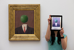 © Licensed to London News Pictures. 14/06/2013. London, UK. A Sotheby's employee stands next to L'Idee' (1966, est. GB£1,800,000-2,500,000) by French surrealist Rene Magritte at the press view for a Sotheby's auction in London today (14/06/2013). The Impressionist and Modern Art Evening Sale takes place on the 19th of June 2013 at Sotheby's New Bond Street premises.  Photo credit: Matt Cetti-Roberts/LNP