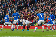 Uche Ikpeazu of Hearts hits a shot on the turn during the Betfred Scottish League Cup semi-final match between Rangers and Heart of Midlothian at Hampden Park, Glasgow, United Kingdom on 3 November 2019.