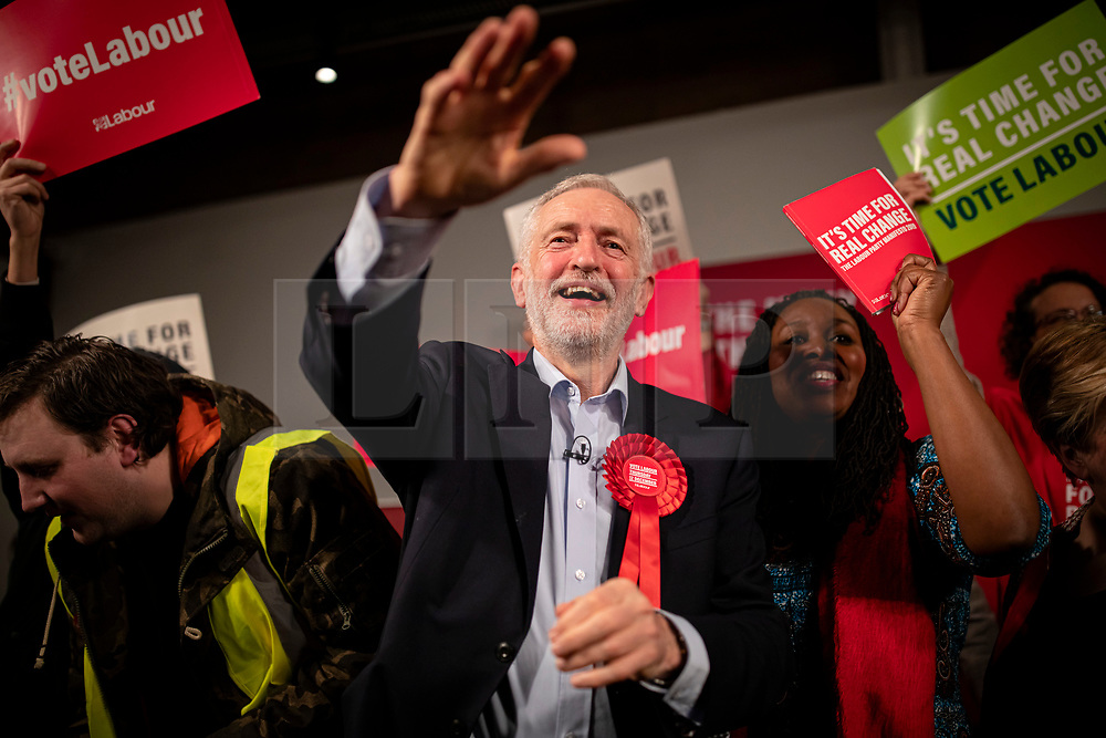 © Licensed to London News Pictures. 11/12/2019. London, UK. Leader of the Labour Party Jeremy Corbyn (centre) on stage at the end of the party's final election rally of the campaign. Voters will head to polling stations tomorrow for the 2019 General Election. Photo credit: Rob Pinney/LNP