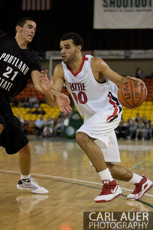 November 29th, 2008:  Anchorage, Alaska - Seattle University's Mike Boxley (00) drives against Portland State forward Phil Nelson (21) in the third place game on the final day of the Great Alaska Shootout.