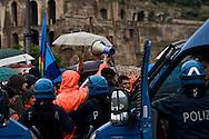 Roma 12 Novembre 2013<br /> Sciopero dei lavoratori della Metro C  per  chiedere lo sblocco, come da accordi gi&agrave; sottoscritti, con il Comune di Roma,  del pagamento dei 253 milioni dovuti al consorzio metro C. Operai  in corteo verso il Campidoglio vengono fermati dalla polizia<br /> Rome November 12, 2013<br /> Strike of  workers  of the construction site subway C,  ask for the unlocking , as from undersigned accords already  with the City of Rome, of  the payment of 253 million due to the consortium  subway C. Workers in march to the Capitol are stopped by the police