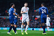 Leeds United defender Stuart Dallas (15) reacts with a pained expression after having a shot during the EFL Sky Bet Championship match between Leeds United and Blackburn Rovers at Elland Road, Leeds, England on 9 November 2019.
