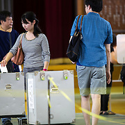 TOKYO, JAPAN - JULY 10 : Voters cast their ballots to vote for parliament's upper house election at a polling station in Tokyo, Japan on July 10, 2016. The revised law has expanded the electorate by 2.4 million people aged 18 and 19, and is designed to give more political say to younger generations. The first Upper house election nation-wide in Japan that 18 years old can vote after government law changes its voting age from 20 years old to 18 years old. (Photo by Richard Atrero de Guzman/NURPhoto)