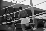Ali vs Lewis Fight, Croke Park,Dublin..1972..19.07.1972..07.19.1972..19th July 1972..As part of his built up for a World Championship attempt against the current champion, 'Smokin' Joe Frazier,Muhammad Ali fought Al 'Blue' Lewis at Croke Park,Dublin,Ireland. Muhammad Ali won the fight with a TKO when the fight was stopped in the eleventh round...Image taken as Lewis is backed onto the ropes by the attacking Ali.
