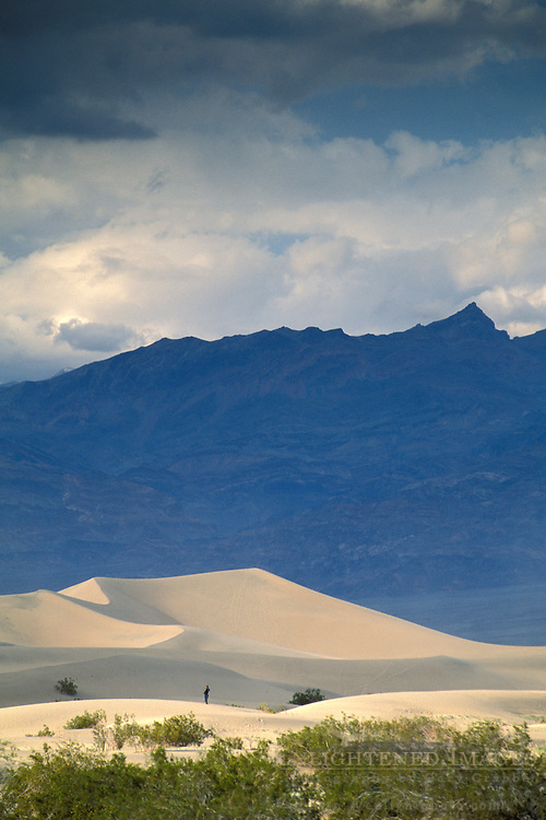 Sand dunes, spring storm clouds, and mountains, Stovepipe Wells, Death Valley National Park, California