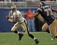 New Orleans quarterback Aaron Brooks (2) scrambles away from St. Louis tackle Jimmy Kennedy (73) during the fourth quarter at the Edward Jones Dome in St. Louis, Missouri, October 23, 2005.  The Rams beat the Saints 28-17.