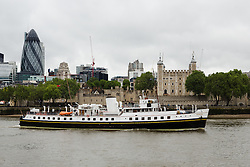 © Licensed to London News Pictures. 31/05/2016. LONDON, UK.  MV Balmoral arrives in central London, passing the Tower of London during rainy, windy weather today. Popular heritage excursion ship MV Balmoral has returned to the Thames for the first time since 2012. The ship, listed on the National Historic Fleet register, was laid up in 2013 and her future looked uncertain but a Bristol-based charity was formed to preserve the vessel and return to her use. She will be undetaking journeys up and down the Thames and around the coast throughout June.  Photo credit: Vickie Flores/LNP