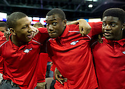 Tay Evans, Ugo Onwuzurike and Christian Sam lock arms during the school song after Allen High School's football state championship community celebration at the Allen Event Center on Wednesday, January 30, 2013 in Allen, Texas. (Cooper Neill/The Dallas Morning News)