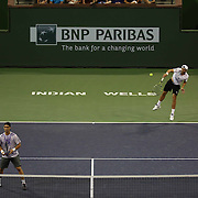 Simone Bolelli and Fabio Fognini defeat Rafael Nadal and Pablo Carreno Busta on Stadium 2 during the 2015 BNP Paribas Open in Indian Wells, California on Wednesday, March 18, 2015.<br /> (Photo by Billie Weiss/BNP Paribas Open)