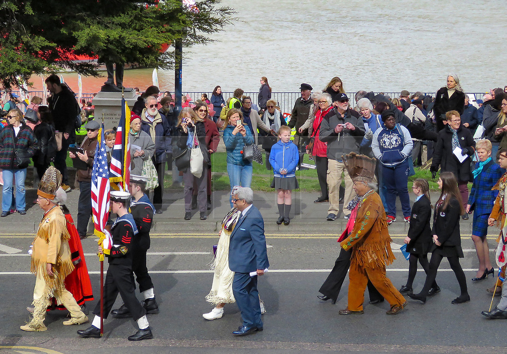 © Licensed to London News Pictures. 21/03/2017. London, UK. Gravesend commemorates the death and burial of Pocahontas in the town 400 years ago today - a parade commenced at St Andrew's Gardens by the side of the river Thames where she would have come to shore on this day 400 years ago having been taken ill on board a ship sailing out of London. Water brought across from Jamestown was poured into the Thames watched by civic dignitaries and native American chiefs at the waters edge. Photo credit: Graham Long/LNP
