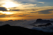 A sunset from the top of the mountains of Gran Canaria, The Canary Islands, Spain. Clouds fill the valleys.