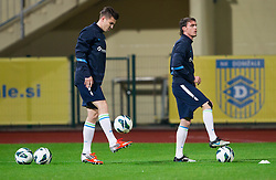Rok Elsner and Ales Mejac during practice session of Slovenian National football team prior to the friendly match against Former Yugoslav republic of Macedonia on November 12, 2012 in Domzale, Slovenia. (Photo By Vid Ponikvar / Sportida)