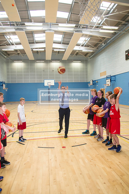 Pictured: Michael Matheson tries his luck from the free throw line<br /> Today, Justice Secretary Michael Matheson visited the Raploch community campus and met young people involved in CashBack-funded basketball sessions. <br />  <br /> Ger Harley   EEm 11 July  2017