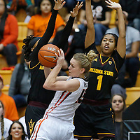Oregon State's Jamie Weisner, center, is blocked from the basket by Arizona State's Peace Amukamara (cq), left, and Arnecia Hawkins, right, in the half of an NCAA college basketball game in Corvallis, Ore., on Monday, Feb. 1, 2016. (AP Photo/Timothy J. Gonzalez)