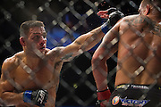 DALLAS, TX - MARCH 14:  Rafael Dos Anjos throws a punch at Anthony Pettis during UFC 185 at the American Airlines Center on March 14, 2015 in Dallas, Texas. (Photo by Cooper Neill/Zuffa LLC/Zuffa LLC via Getty Images) *** Local Caption *** Rafael Dos Anjos; Anthony Pettis