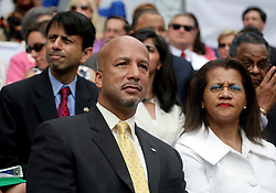 03 May 2010. New Orleans, Louisiana. Inauguration of new mayor Mitch Landrieu at Gallier Hall. Former mayor Ray Nagin and his wife look on with Louisiana governor Bobby Jindal and wife behind. <br /> Photo; Charlie Varley/varleypix.com