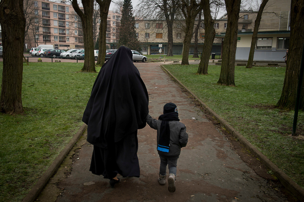 10 years ago, on 27 October 2005 riots broke out in the French suburbs.  It started here with the death of two boys, in Clichy sous Bois, 15 km from Paris, an economically deprived suburb. Mother and child during the midday school break. 22 January 2015, Clichy sous Bois, France.