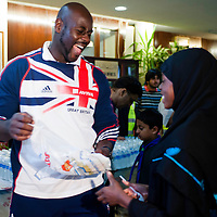 London, UK - 21 July 2012: Team GB Olympic discus thrower Abdul Buhari feeds more than 5000 fasting Muslim and non-Muslim visitors at the Ramadan Iftar 2012 celebrations hosted at the Islamic Cultural Centre (ICC) in Regents Park.