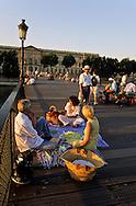 = piknik with friends on the pont des arts on the Seine river  Paris  France    +