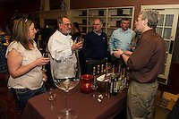 Bob Manley explains the variety of wines made at Hermit Woods Winery during Altrusa's annual Taste of the Lakes Region Sunday evening at Church Landing.    (Karen Bobotas/for the Laconia Daily Sun)